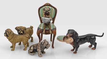 Four Viennese dog figures