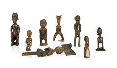 Group of eight wooden figures and loom holders