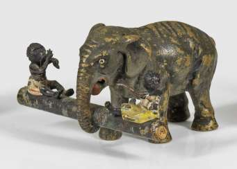 Rare figural group with elephant and African children