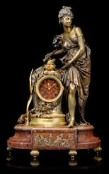 A FRENCH ORMOLU AND PATINATED-BRONZE MOUNTED FIGURAL MANTEL CLOCK
