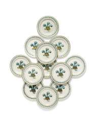 TWELVE ENGLISH PORCELAIN DINNER-PLATES DESIGNED FOR THE PRINCE OF WALES