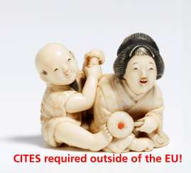 Netsuke of a mother with a son