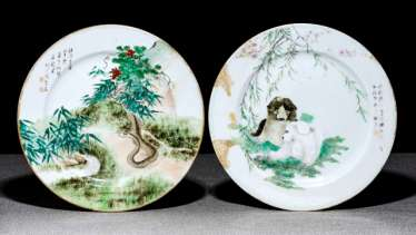 Two plates made of porcelain with animal depictions and inscription
