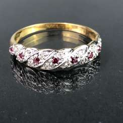 Ladies ring / locking ring: yellow gold and white gold 585, rubies, and diamonds.