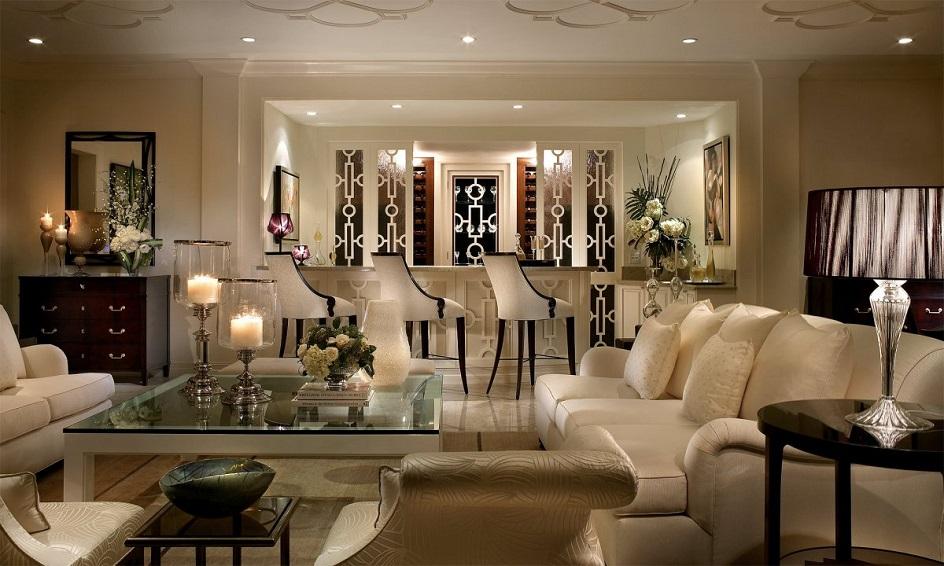 Стиль арт-деко в интерьере. Интерьер гостиной с большим стеклянным столом и барными стульями